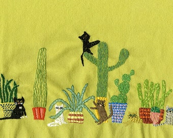 Cactus cats. Original embroidery by Vivienne Strauss.