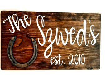 Customizable hand painted reclaimed wood sign with horseshoe