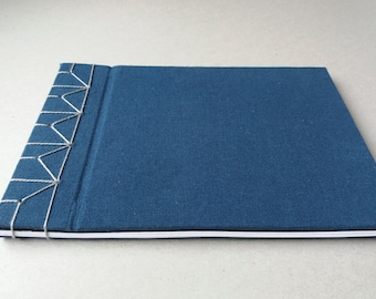 Hardcover A5 sketchbook with blank white pages
