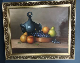 An authentic and original still life oil painting on canvas with gilt frame by w james