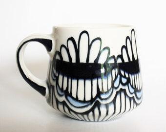 Deep cobalt and pale blue porcelain coffee mug