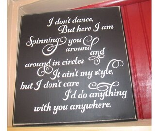 I Don't Dance, wooden sign