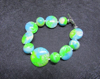 Bracelet made of round beads and flat beads polymer clay