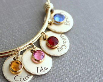 Gold plated stainless steel bracelet, Children's names Hand stamped NuGold discs, Swarovski crystal birthstones and wire bangle bracelet