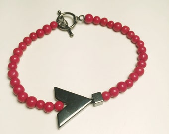 Red beaded bracelet with silver hematite chevron