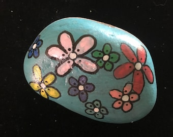 Hand painted rock with flowers