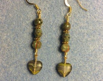 Opaque green striped Czech glass heart bead dangle earrings adorned with green Picasso Czech glass beads.