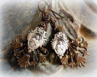 consecration one of a kind vintage assemblage earrings . vintage holy medals sacred heart jesus older vintage brass components