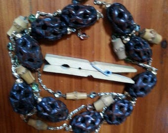 10 brown carved celluloid beads
