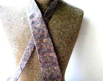 Luxurious vintage 80s all silk  necktie with pastel multicolor print of  the paisley. Made Christian Dior in USA.