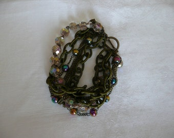 Antigue brass, silk-coated chain and bead multistrand bracelet
