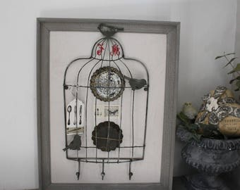 Frame home decor with bird cage and molds ancients