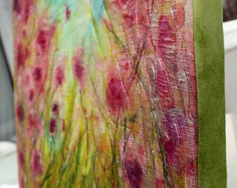 Mount your art quilt over a framework, like a canvas painting. A mounting upgrade for art quilts purchased from Barbara Harms Fiber Art