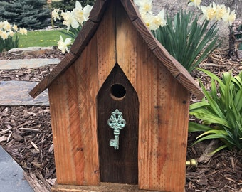 Charming Rustic outdoor Birdhouse with turquoise accent