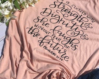 She is Clothed with Strength and Dignity Shirt • Christian Shirt • Bible Verse Shirt • Women's Shirt • Bella Canvas