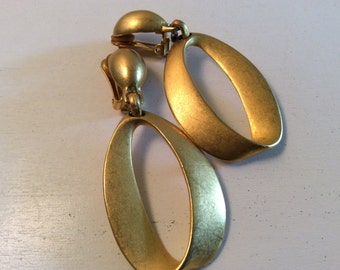 Gold Tone Zeroes Clip Earrings by The Limited