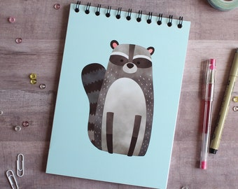 NOTEBOOK. A5 Cute Raccoon Spiral Notebook. Soft 300 gsm Card Cover. 100 lined pages. Matte lamination pleasant to the touch.