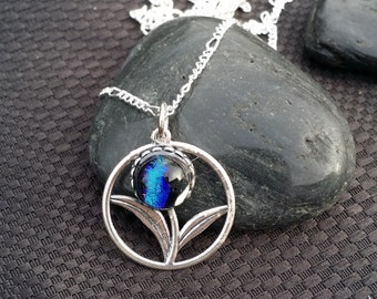 Sterling silver flower pendant with blue dichroic glass center