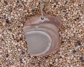 Polished ribbonstone pendant