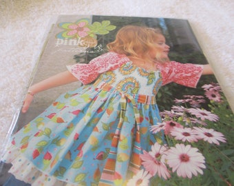 Paper Pattern for a girl's Mia Top by Pink Fig by Chelsea Andersen in sizes 12 months- 10