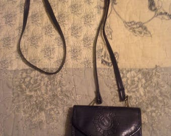 Mini purse with long shoulder strap.black