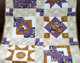 Handmade patchwork lap quilt or throw. Could be a wall hanging.