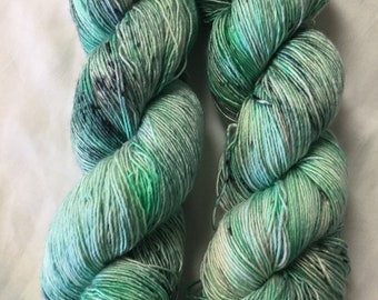 Hand dyed fiber.  70/30% Superwash Merino & silk.  Colorway is St. Paddy.  Greens and speckles.