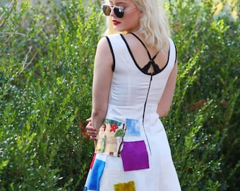 S. Swatch dress. Size small white satin dress with black binding and colorful fabric squares.