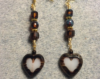 Brown and white Czech glass heart bead dangle earrings adorned with brown Czech glass beads.