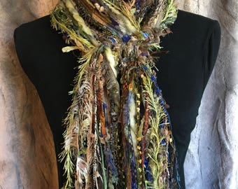 Unique fashion scarf in shades of green, blue, taupe, purple, copper and brown.