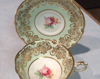 Mint green Paragon teacup and saucer, pink rose in center, gold edging design, teacup collector, gift,