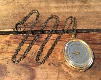 romantic vintage oval grey and golden color watch necklace with a long brass soldered chain