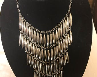 Silver statement necklace. Silver tubes multilayered statement necklace