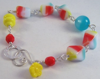 Circus Act.. Red, yellow, turquoise and white glass bracelet
