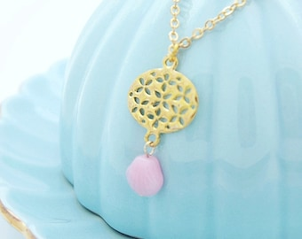 petal ovals necklace. cherry blossom cut-out disc with pink shell glass bead