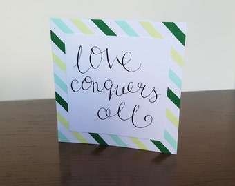 Love conquers all greetings card