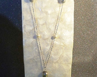 Super long silver chain necklace.