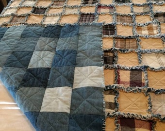 Ragtime quilt of cotton with a middle layer of poly-cotton batting, and recycled denim backing. QT12