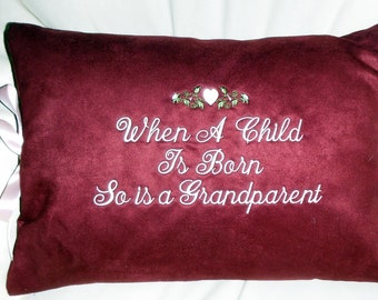 When a Child is Born so is a Grandparent pillow.