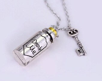 Alice in Wonderland inspired necklace with Drink Me bottle and key pendants on silver chain