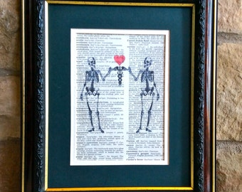 Skeletons holding Caduceus with Heart on Vintage Dorland's Medical Dictionary Page
