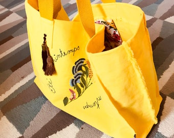 Tote bag yellow canvas embroidered wild flowers and tassels for spring summer.