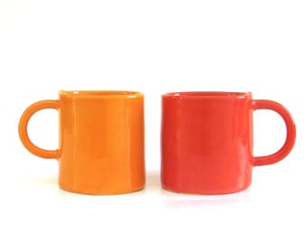 two hand built porcelain petite cups  ...   festive coral red and pumpkin orange  ...   set of espresso cups
