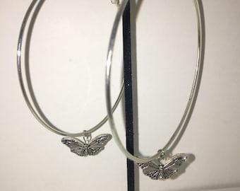 Butterfly effect hoop earrings
