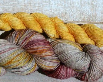 Hand dyed sock yarn in greys and yellows with a mini skein of gold for toes and heels, solar dyed yarn for your socks and shawls with  mini