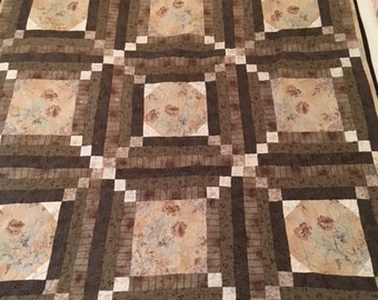 Quilt with soft beige/brown colors