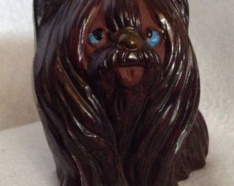 Adorable ceramic long haired dog needs a home!