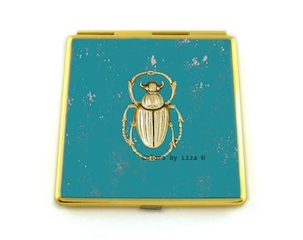 Turquoise Enamel Compact Mirror Embellished with a Scarab in Rich Antique Gold Hand Painted with Silver Splash Art Nouveau Insect