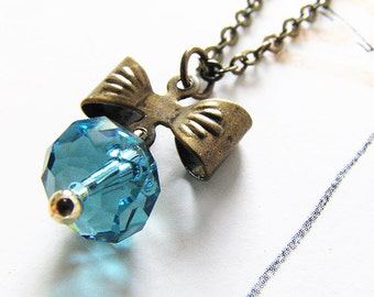 ethereal bow necklace. faceted Swarovski crystal stone with petite ribbon