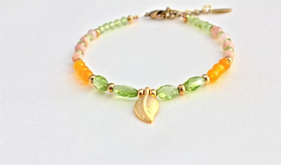 semi-precious stones bracelet, peridot, moonstone and sunflower jade with golden plated leaf charm